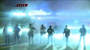 police quashing protests at Ferguson, Missouri
