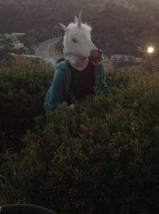 Audrey wearing a unicorn mask in the foothills of LA